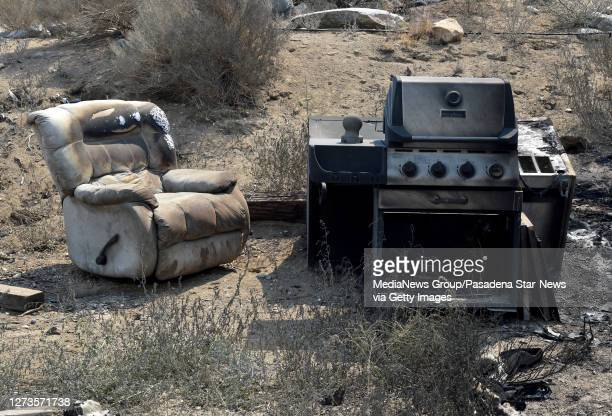 Burned out bbq and char along with structures that Frank Kenton lost during the Bobcat Fire last night in Juniper Hills on Saturday September 19 2020