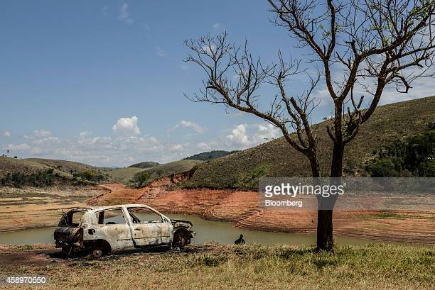 A burned out car sits at the Jaguari Reservoir near Sao Jose dos Campos in the state of Sao Paulo Brazil on Thursday Nov 13 2014 The Jaguari River...
