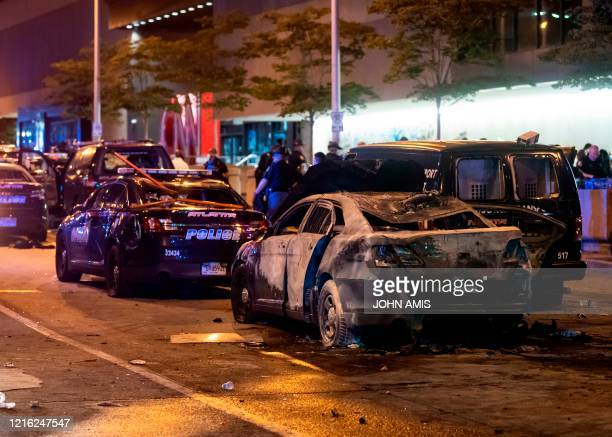 A burned out car sits idle during rioting and protests in Atlanta on May 29 2020 The death of George Floyd on May 25 while under police custody has...