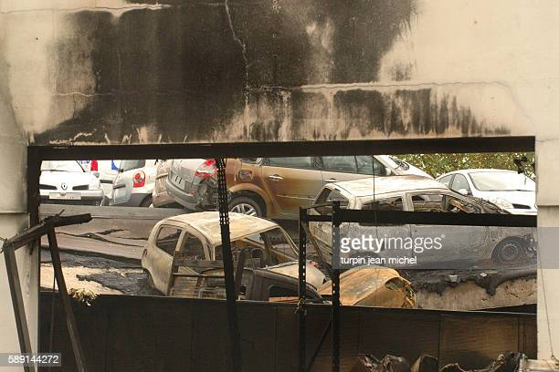Burned out cars are all that remain at this Renault car showroom as rioting and civil disorder continues unabated for the 11th consecutive night in...