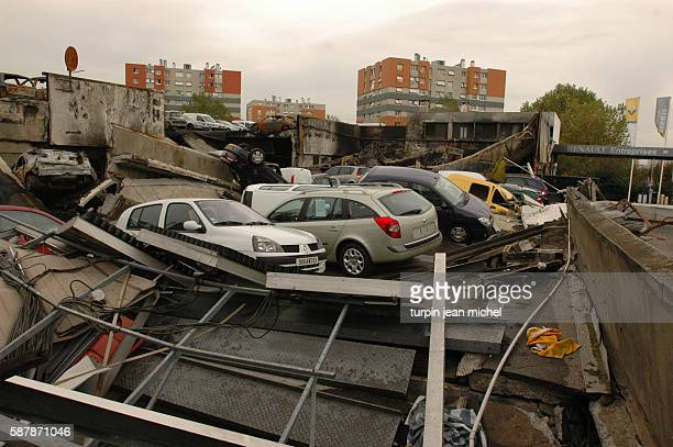 Burned out cars are all that remain of this Renault car showroom as rioting and civil disorder continues unabated for the 11th consecutive night in...