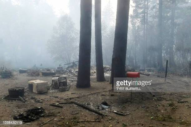 Burned out house is seen after the passing of the Holiday Farm fire in McKenzie Bridge, Oregon on September 9, 2020. - Hundreds of homes including...