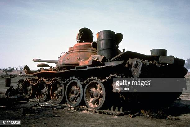A burned out Iraqi T55 main battle tank lies abandoned at the edge of an oil field following Operation Desert Storm