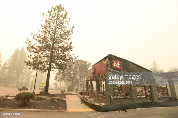A burned out Jack In The Box restaurant is seen in downtown Paradise California after the Camp fire tore through on November 10 2018 Firefighters in...
