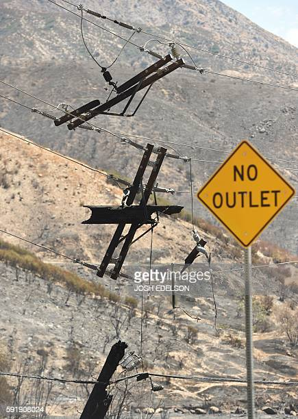 Burned out power lines are seen suspended Keenbrook California on August 18 2016 The Blue Cut Fire has charred more than 35000 acres causing more...