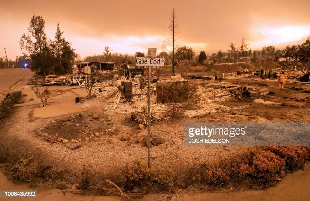 TOPSHOT Burned out properties are seen near the Lake Keswick Estates area during the Carr fire in Redding California on July 27 2018 Two firefighters...