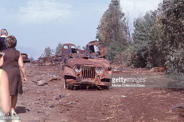 Burned remains of a military jeep vehicle used in the Six Day War in the Golan Heights outside the town of Quneitra Syria November 1967