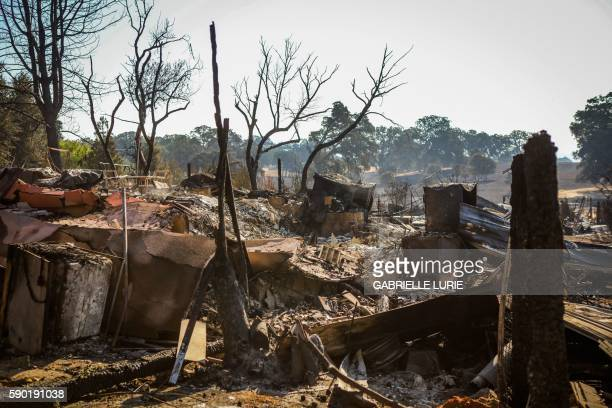 A burned residence is seen off of Winchester Street after the Clayton Fire burned through Lower Lake California on August 16 2016 A man was arrested...