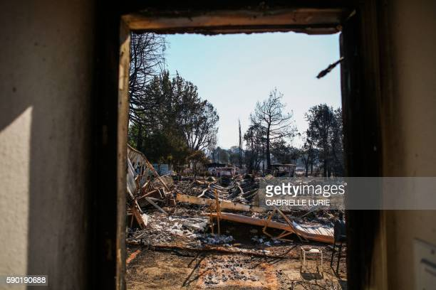Burned residences are seen in a fireravaged neighborhood after the Clayton Fire burned through Lower Lake California on August 16 2016 A man was...