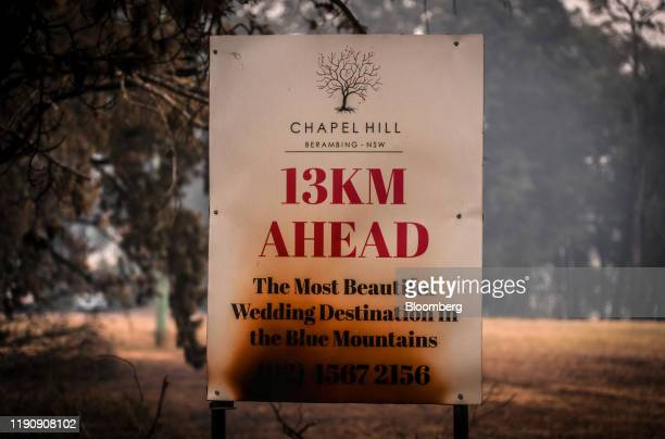 A burned sign for Chapel Hill stands on the outskirts of Bilpin New South Wales Australia on Sunday Dec 29 2019 With a state of emergency declared in...