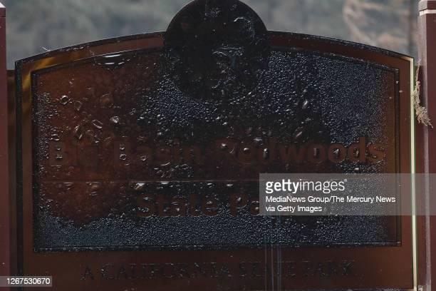 """Burned sing that reads """"Big Basin Redwoods State Park"""" is burned during a blaze in Boulder Creek, Calif., on Thursday, Aug. 20, 2020."""