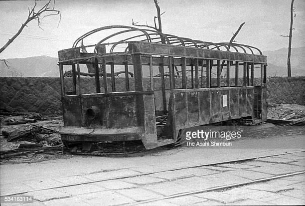 Burned tram by the atomic bomb remains on the street 70m east from Kamiyacho crossing in August, 1945 in Hiroshima, Japan. The world's first atomic...