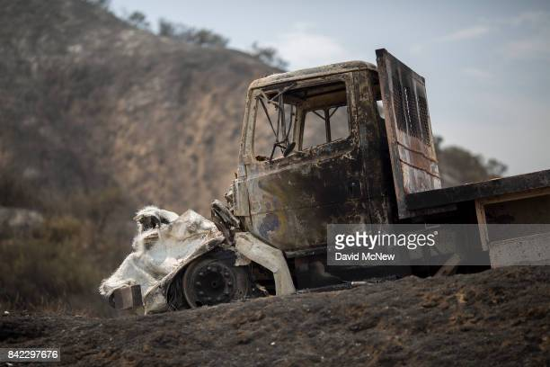 A burned truck is seen at the La Tuna Fire on September 3 2017 near Burbank California At nearly 6000 acres the fire is the biggest fire in terms of...