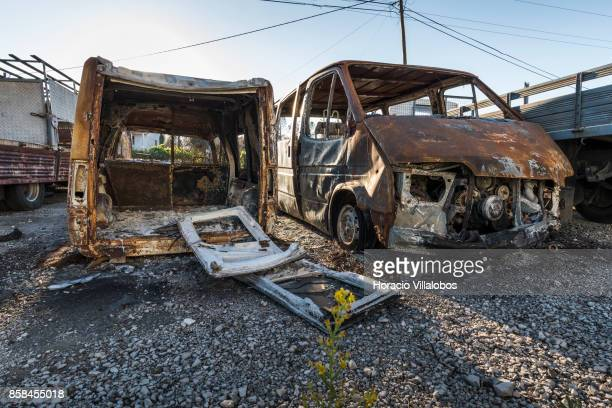 Burned vehicles seen four months after the forest fire on October 06 2017 in Vila Facaia Portugal Pedrogao Grande municipality suffered the death of...