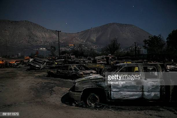 Burned vehicles sit in the glow of the full moon on Highway 138 as the Blue Cut fire continues to ravage San Bernardino County Calif on Aug 18 2016
