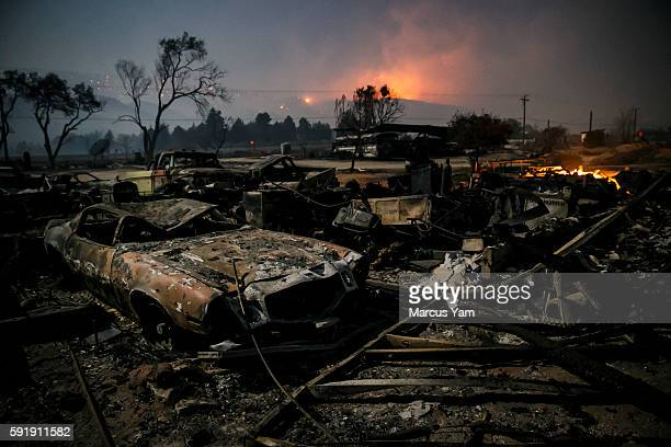 Burned vehicles sit in the glow of the full moon on Highway 138 in Phelan as the Blue Cut fire continues to ravage San Bernardino County Calif on Aug...