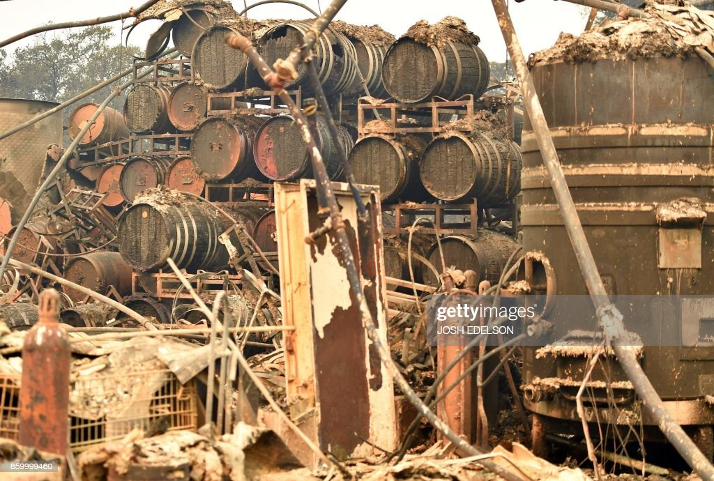 Burned wine barrels are seen at a destroyed Paradise Ridge Winery in Santa Rosa in California on October 10, 2017. Firefighters battled wildfires in California's wine region on Tuesday as the death toll rose to 15 and thousands were left homeless in neighborhoods reduced to ashes. /