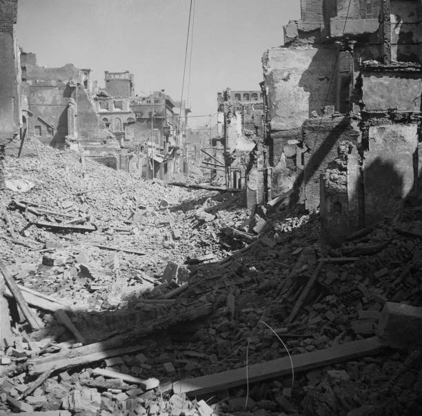 Burnedout and ruined buildings in the Katra Jaimal Singh area of Amritsar after communal violence in the city during the Partition of British India...