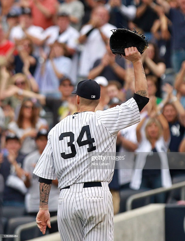 A.J. Burnett #34 of the New York Yankees salutes the crowd as he leaves the game in the eighth inning against the Boston Red Sox on September 25, 2011 at Yankee Stadium in the Bronx borough of New York City.