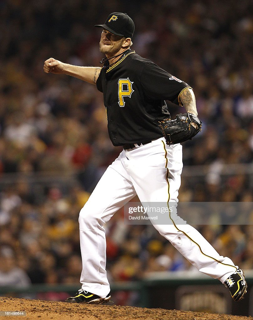 A.J. Burnett #34 of the Pittsburgh Pirates celebrates after striking out Henry Rodriguez #36 of the Cincinnati Reds (not pictured) for the final out of the seventh inning on September 21, 2013 at PNC Park in Pittsburgh Pennsylvania. The Pirates defeated the Reds 4-2.