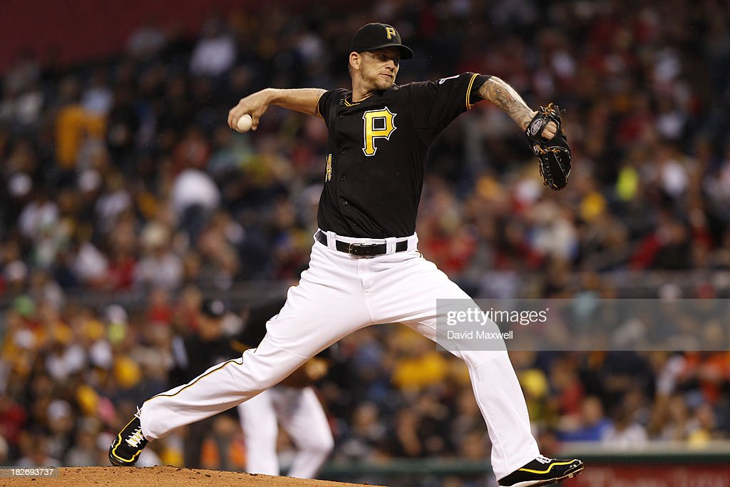 A.J. Burnett #34 of the Pittsburgh Pirates pitches against the Cincinnati Reds during the first inning of their game on September 21, 2013 at PNC Park in Pittsburgh Pennsylvania. The Pirates defeated the Reds 4-2. (Photo by David Maxwell/Getty Images) ~~~