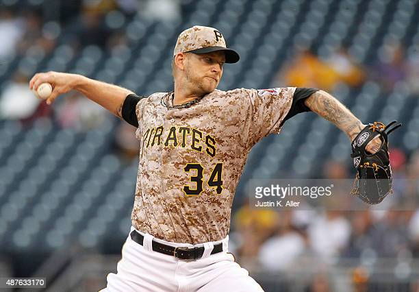 J Burnett of the Pittsburgh Pirates pitches in the first inning during the game against the Milwaukee Brewers at PNC Park on September 10 2015 in...