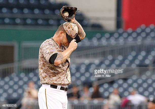 J Burnett of the Pittsburgh Pirates reacts after giving up a two run home run in the first inning during the game against the Milwaukee Brewers at...