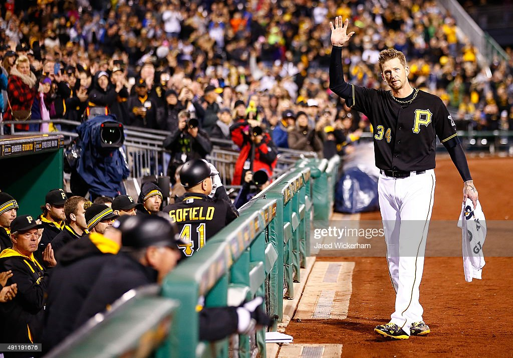 A.J. Burnett #34 of the Pittsburgh Pirates waves to the crowd while receiving a curtain call after being pulled from the game in the 7th inning in his final career regular season game against the Cincinnati Reds during the game at PNC Park on October 3, 2015 in Pittsburgh, Pennsylvania.