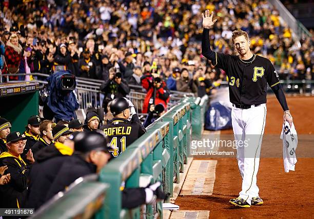 J Burnett of the Pittsburgh Pirates waves to the crowd while receiving a curtain call after being pulled from the game in the 7th inning in his final...