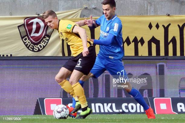 Burnic Dzenis of Dynamo Dresden and Pantovic Milos of VfL Bochum 1848 battle for the ball during the second Bundesliga match between Dynamo Dresden...