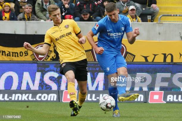 Burnic Dzenis of Dynamo Dresden and Vitaly Janelt of VfL Bochum 1848 battle for the ball during the second Bundesliga match between Dynamo Dresden...