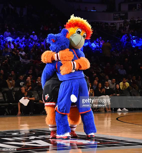 Burnie the Miami Heat Mascot and Franklin from the Philadelphia 76ers give each other a hug during the 2015 NBA AllStar Rookie Rising Stars Challenge...