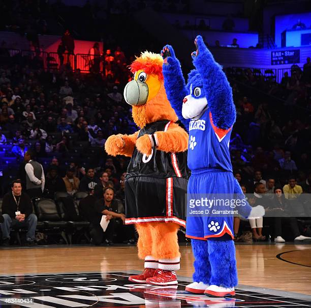 Burnie the Miami Heat mascot and Franklin from the Philadelphia 76ers mascot wave to the fans during the 2015 NBA AllStar Rookie Rising Stars...