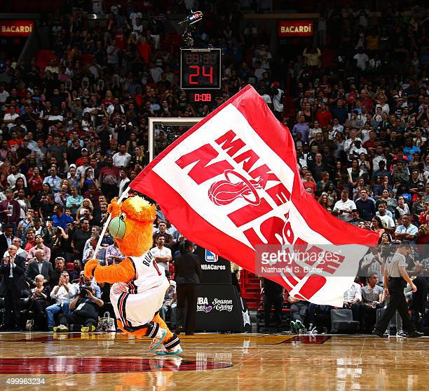 Burnie the Miami Heat mascot gets the crowd into the game against the Oklahoma City Thunder on December 3 2015 at American Airlines Arena in Miami...