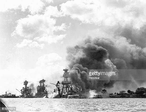 Burning and damaged ships at Pearl Harbor, December 7, 1941. Left to right are the USS West Virginia, the USS Tennessee and the USS Arizona.