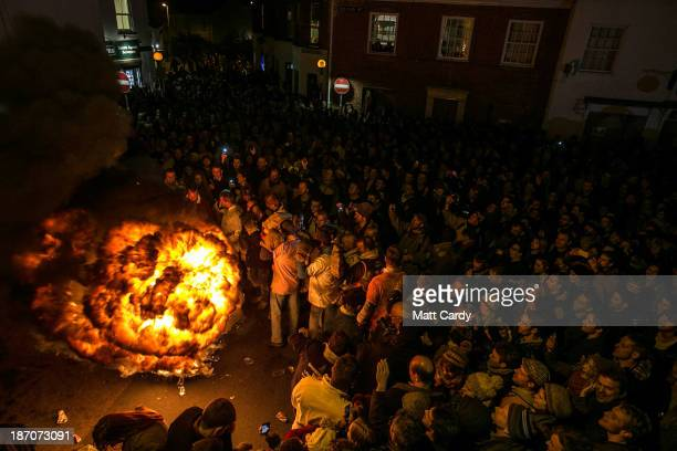 A burning barrel soaked in tar blazes at the annual Ottery St Mary Tar Barrel festival on November 5 2013 in Ottery St Mary Devon England The...