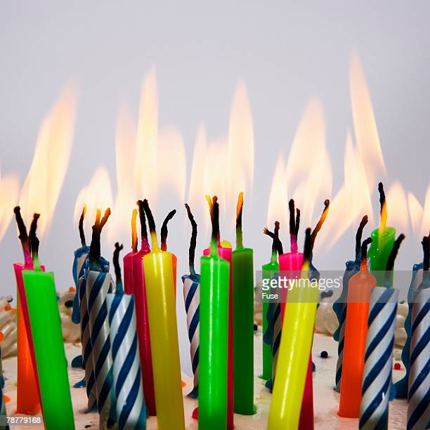 burning birthday candles - birthday cake lots of candles stock photos and pictures
