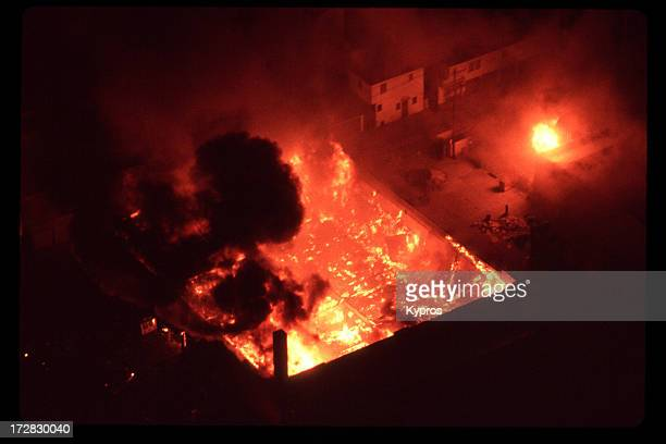 Burning building during the 1992 Los Angeles Riots. The rioting followed the acquittal of the police officers who had been videotaped beating Rodney...