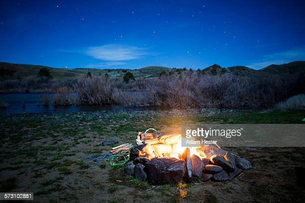 Burning campfire in remote field, Painted Hills, Oregon, United States