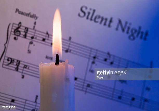 Burning Candle and Sheet Music
