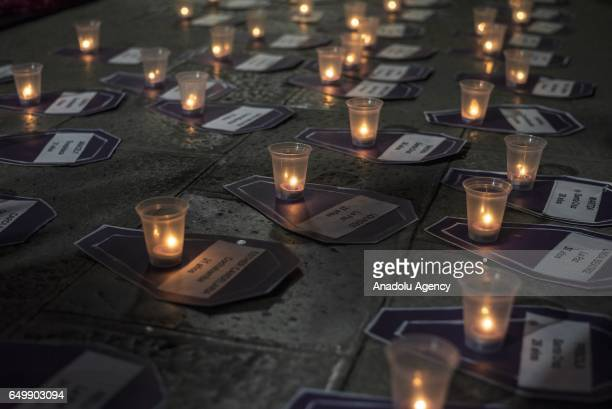 Burning candles are seen as thousand of women mostly including workers march against the discrimination violence and gender violence that is...