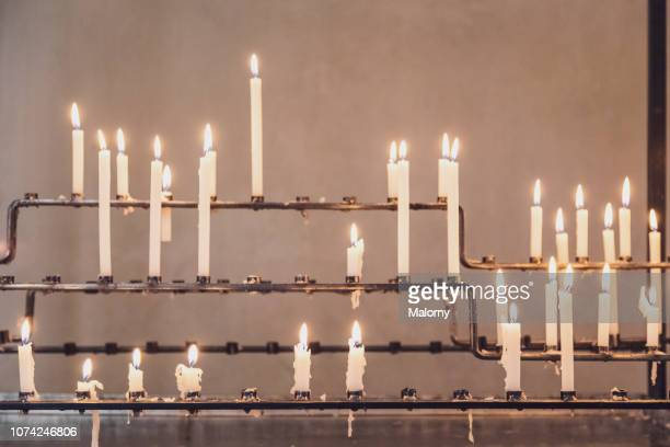 burning candles in a church. - ceremony stock pictures, royalty-free photos & images