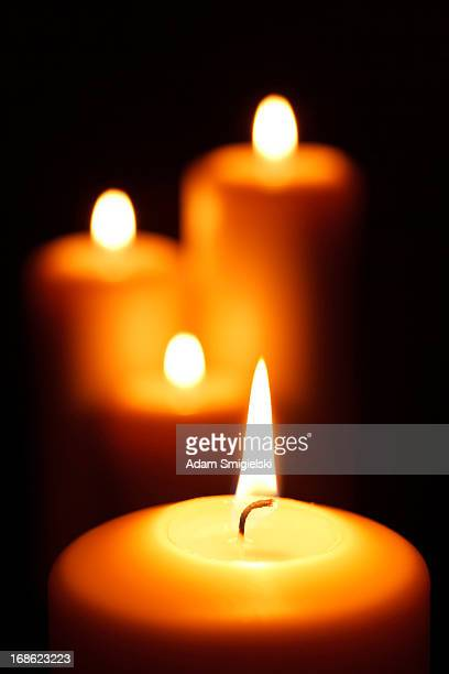 burning candles in blackness