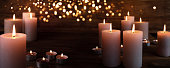 Burning candles in darkness