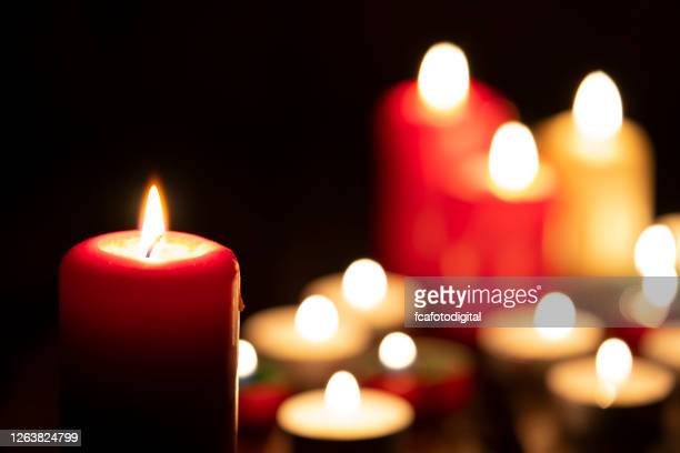 burning candles in the dark - mourning stock pictures, royalty-free photos & images