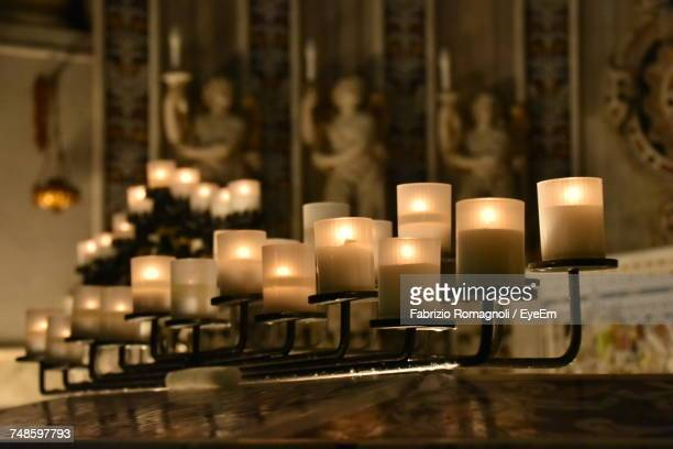 Burning Candles On Altar In Church