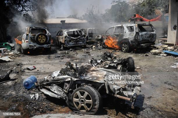 Burning cars are seen at the scene where a car bomb exploded in Mogadishu on January 29 20 19 Two people were killed and five wounded on January 29...
