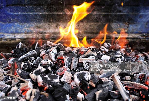 Burning charcoal on barbecue grill