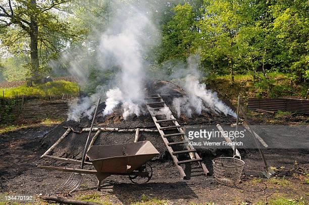 Burning charcoal pile in the final stage, Walpersdorf, Siegen-Wittgenstein district, North Rhine-Westphalia, Germany, Europe