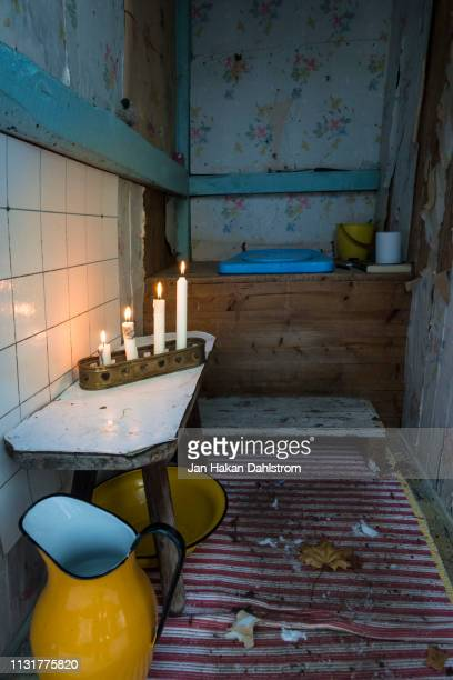 Burning Christmas candles in privy